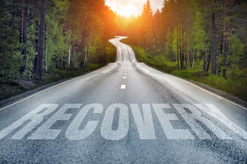 image of a highway with RECOVERY written on it